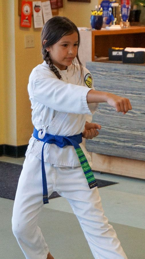 young student practicing martial arts moves